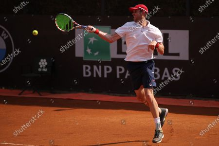 Stock Photo of Sam Querrey of the US hits a forehand in his first round match against Pedro Martinez of Spain at the Italian Open in Rome, Italy, 15 September 2020.