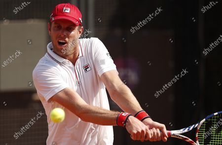 Stock Image of Sam Querrey of the US hits a backhand in his first round match against Pedro Martinez of Spain at the Italian Open in Rome, Italy, 15 September 2020.