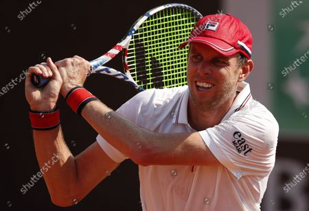 Sam Querrey of the US hits a backhand in his first round match against Pedro Martinez of Spain at the Italian Open in Rome, Italy, 15 September 2020.