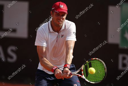 Stock Picture of Sam Querrey of the US hits a backhand in his first round match against Pedro Martinez of Spain at the Italian Open in Rome, Italy, 15 September 2020.