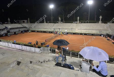 Rain starts during the first round match between British player Kyle Edmund and Marco Cecchinato of Italy at the Italian Open in Rome, Italy, 15 September 2020.