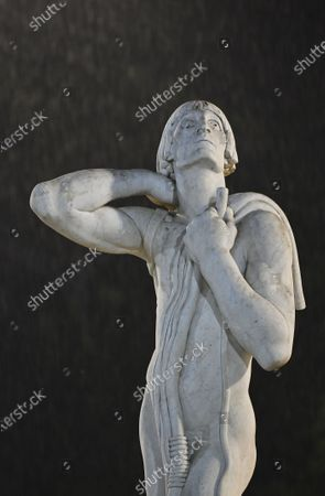 Stock Photo of One of the statues around Pietrangeli Court as rain starts during the first round match between British player Kyle Edmund and Marco Cecchinato of Italy at the Italian Open in Rome, Italy, 15 September 2020.