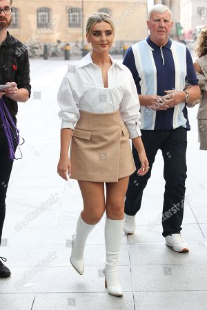 Perrie Edwards walks over to Radio 1 ahead of their Live Lounge performance