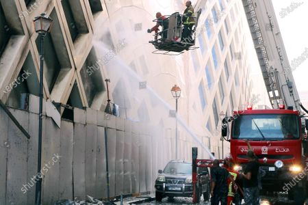 Firefighters extinguish a building under construction that was designed by the late world-renowned British-Iraqi architect Zaha Hadid, at Beirut Souks in Beirut, Lebanon, 15 September 2020. The cause of the fire is still yet to be known.