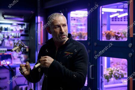 Stock Photo of Mark Ivanir as Misha Popov