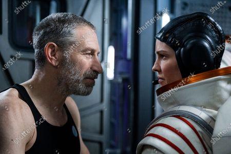 Mark Ivanir as Misha Popov and Hilary Swank as Emma Green