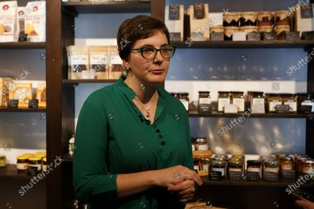 """Author of the idea, cheesemaker Inna Pryhara is seen during the opening of the """"Selyskyi Rokash"""" - the first local producs shop opened in the area, Nyzhnie Selyshche village, Khust Region, Zakarpattia Region, western Ukraine."""