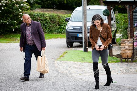 Emmerdale - Ep 8848 Tuesday 29th September 2020 Tracy Metclafe confronts Meena, as played by Paige Sandhu, at the shop over skipping her B&B bill and Rishi Sharma, as played by Bhasker Patel, steps in and offers to pay it.