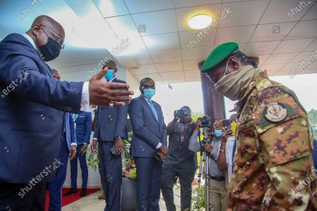 Ghanaian President, Nana Akufo-Addo (L) President and Chairman of the Economic Community of West African States greets Mali military members of the National Committee for the Salvation of the People (CNSP) as they arrive at Peduasi Lodge, Accra, Ghana, 15 September 2020. The Economic Community of West African States (ECOWAS) leaders are holding a summit in Ghana to discuss the Mali transition with the CNSP. The president and prime minister of the transition are expected to be appointed. Mali President Boubakar Keita resigned 19 August 2020 after a coup by the military on 18 August 2020.