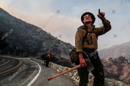 Arcadia, CA, September 14, 2020 - Mormon Lake, Arizona Hotshot Squad Boss Jessy Twin, looks over charred hillsides after clearing brush near Chantry Flat Rd. Near Santa Anita Dam as crews continue to battle the Bobcat Fire. Twin said his crew is on it's sixth day of cutting line along the Western and Southern fronts. (Robert Gauthier/ Los Angeles Times)