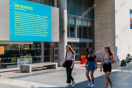 Stock Image of On Nurses by Roger Robinson - Everyday Heroes is an outdoor exhibition on walls and windows around the Southbank Centre. It celebrates the contributions that key workers and frontline staff have made during the coronavirus pandemic.