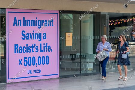 Jeremy Deller, An Immigrant Saving a Racist's Life x 500,000, 2020 - Everyday Heroes is an outdoor exhibition on walls and windows around the Southbank Centre. It celebrates the contributions that key workers and frontline staff have made during the coronavirus pandemic.