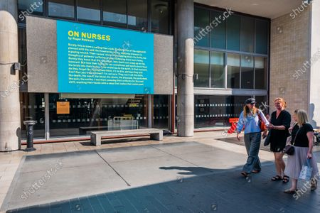 Stock Photo of On Nurses by Roger Robinson - Everyday Heroes is an outdoor exhibition on walls and windows around the Southbank Centre. It celebrates the contributions that key workers and frontline staff have made during the coronavirus pandemic.