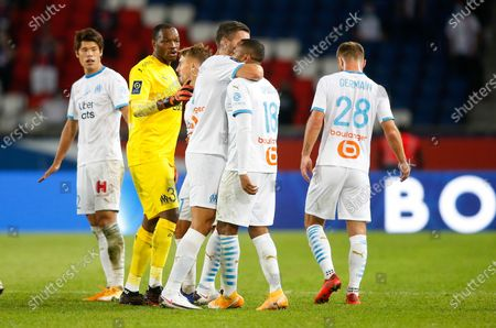 OM's defender Jordan Amavi (CR) is comfoted by Kevin Strootman, Steve Mandanda and teammates as he chashes with PSG's players