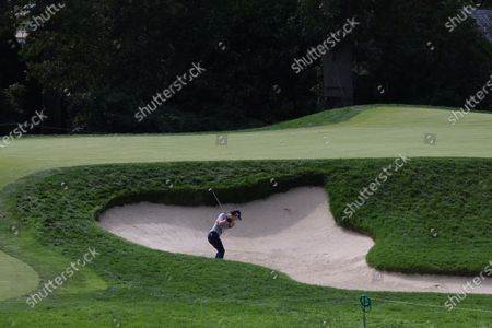 Ryo Ishikawa of Japan hits out of a bunker on the tenth hole during a practice round for the 2020 US Open at Winged Foot Golf Club in Mamaroneck, New York, USA, 15 September 2020. The 2020 US Open will be played from 17 September through 20 September in front of no fans due to the ongoing coronovirus pandemic.
