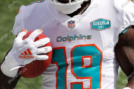 Stock Picture of Miami Dolphins jersey showing a patch honoring former coach Don Shula's 347 career victories is seen before an NFL football game between the New England Patriots and the Miami Dolphins at Gillette Stadium, in Foxborough, Mass