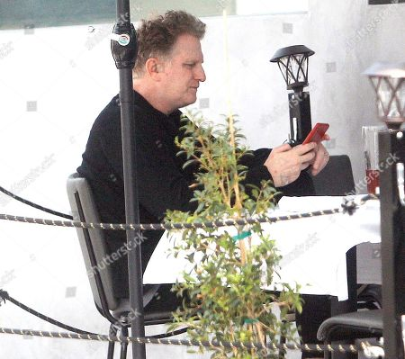 Michael Rapaport is seen having a drink at a restaurant.