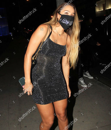 Stock Photo of Sommer Ray wears her face mask on a night out.