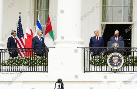 (L-R) UAE Foreign Affairs Minister Sheikh Abdullah bin Zayed bin Sultan Al Nahyan,  Israeli Prime Minister Benjamin Netanyahu, US President Donald J. Trump and Bahrain Foreign Affairs Minister Sheikh Khalid Bin Ahmed Al-Khalifa during the Abraham Accords signing ceremony, which normalizes relations between the United Arab Emirates and Bahrain with Israel, on the South Lawn of the White House in Washington, DC, USA, 15 September 2020.