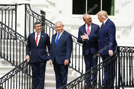 (L-R) UAE Foreign Affairs Minister Sheikh Abdullah bin Zayed bin Sultan Al Nahyan, Israeli Prime Minister Benjamin Netanyahu, Bahrain Foreign Affairs Minister Sheikh Khalid Bin Ahmed Al-Khalifa and US President Donald J. Trump during the Abraham Accords signing ceremony, which normalizes relations between the United Arab Emirates and Bahrain with Israel, on the South Lawn of the White House in Washington, DC, USA, 15 September 2020.