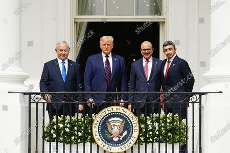 Stock Photo of (L-R) Israeli Prime Minister Benjamin Netanyahu, US President Donald J. Trump, Bahrain Foreign Affairs Minister Sheikh Khalid Bin Ahmed Al-Khalifa, and UAE Foreign Affairs Minister Sheikh Abdullah bin Zayed bin Sultan Al Nahyan during the Abraham Accords signing ceremony, which normalizes relations between the United Arab Emirates and Bahrain with Israel, on the South Lawn of the White House in Washington, DC, USA, 15 September 2020.