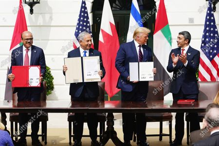 (L-R) Bahrain Foreign Affairs Minister Sheikh Khalid Bin Ahmed Al-Khalifa, Israeli Prime Minister Benjamin Netanyahu, US President Donald J. Trump and UAE Foreign Affairs Minister Sheikh Abdullah bin Zayed bin Sultan Al Nahyan during the Abraham Accords signing ceremony, which normalizes relations between the United Arab Emirates and Bahrain with Israel, on the South Lawn of the White House in Washington, DC, USA, 15 September 2020.