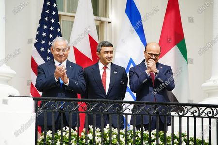 (L-R) Israeli Prime Minister Benjamin Netanyahu, UAE Foreign Affairs Minister Sheikh Abdullah bin Zayed bin Sultan Al Nahyan and Bahrain Foreign Affairs Minister Sheikh Khalid Bin Ahmed Al-Khalifa as US President Donald J. Trump arrive for the Abraham Accords signing ceremony, which normalizes relations between the United Arab Emirates and Bahrain with Israel, on the South Lawn of the White House in Washington, DC, USA, 15 September 2020.