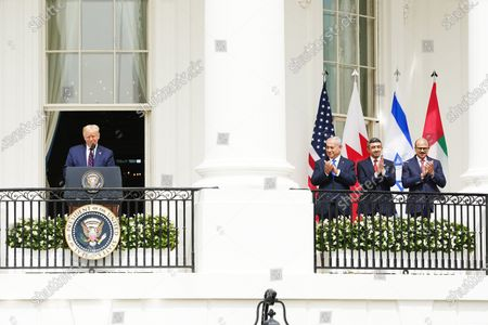 US President Donald J. Trump (L) speaks as (2L-R) Israeli Prime Minister Benjamin Netanyahu, UAE Foreign Affairs Minister Sheikh Abdullah bin Zayed bin Sultan Al Nahyan and Bahrain Foreign Affairs Minister Sheikh Khalid Bin Ahmed Al-Khalifa during the Abraham Accords signing ceremony, which normalizes relations between the United Arab Emirates and Bahrain with Israel, on the South Lawn of the White House in Washington, DC, USA, 15 September 2020.