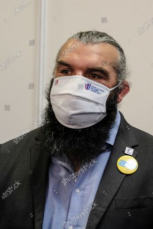 "Stock Image of French rugby player Sebastien Chabal wearing a ""Rugby World Cup 2023"" mask at the Jeunes d Avenirs show"