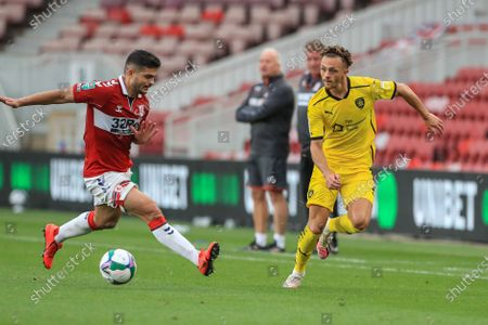Jordan Williams (2) of Barnsley passes the ball as Sam Morsy (5) of Middlesbrough tries to block