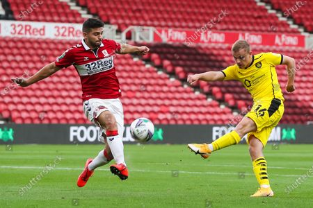 Barnsley midfielder Luke Thomas (16) has a shot blocked by Middlesbrough midfielder Sam Morsy (5) during the EFL Cup match between Middlesbrough and Barnsley at the Riverside Stadium, Middlesbrough