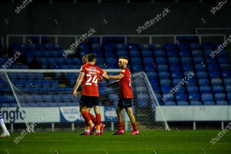 Rhys Norrington-Davies celebrates with goalscorer Jordan Clark at full time.; Madejski Stadium, Reading, Berkshire, England; English Football League Cup, Carabao Cup Football, Reading versus Luton Town.