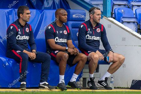 Reading assistant first team coach Nuno Miguel Gomes Bentes Lampreia, Reading first team coach Quinton Fortune, Reading first team coach John O'Shea during the EFL Cup match between Reading and Luton Town at the Madejski Stadium, Reading