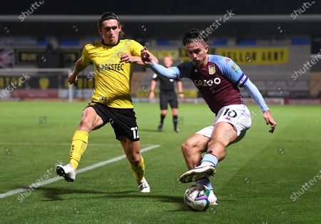 Burton's Ben Fox, left, and Aston Villa's Jack Grealish challenge for the ball during the English League Cup soccer match between Burton Albion and Aston Villa at Pirelli Stadium in Burton, England