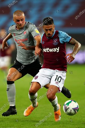 Charlton Athletic's Charlie Barker vies for the ball with West Ham's Manuel Lanzini, right, during the English League Cup soccer match between West Ham United and Charlton Athletic at London stadium in London