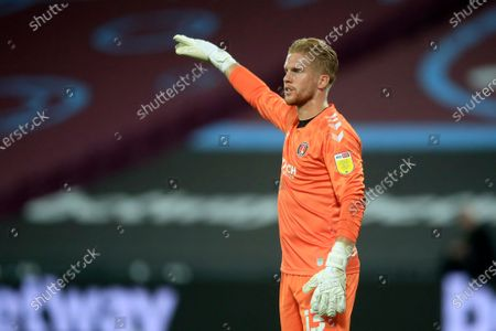 Charlton Athletic's goalkeeper Ben Amos gestures during the English League Cup soccer match between West Ham United and Charlton Athletic at London stadium in London