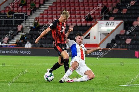 Martin Kelly (34) of Crystal Palace makes a crucial tackle on Sam Surridge (14) of AFC Bournemouth during the EFL Cup match between Bournemouth and Crystal Palace at the Vitality Stadium, Bournemouth