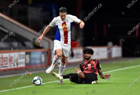 Stock Image of Martin Kelly (34) of Crystal Palace is tackled by Philip Billing (29) of AFC Bournemouth during the EFL Cup match between Bournemouth and Crystal Palace at the Vitality Stadium, Bournemouth