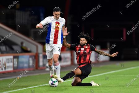 Martin Kelly (34) of Crystal Palace is tackled by Philip Billing (29) of AFC Bournemouth during the EFL Cup match between Bournemouth and Crystal Palace at the Vitality Stadium, Bournemouth