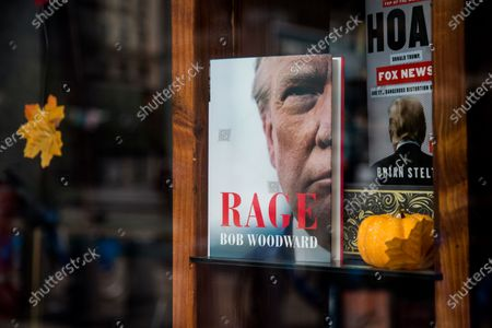 A copy of the book by Bob Woodward, 'Rage' can be seen available outside a bookstore in New York, New York, USA, 15 September 2020. The book is released after recordings during interviews with US President Donald J. Trump became public, in which he recognized that he underestimated intentionally the gravity of the coronavirus pandemic.