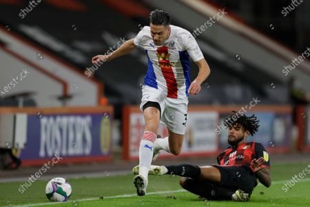 Crystal Palace's Martin Kelly is tackled by Bournemouth's Philip Billing during the English League Cup soccer match between Bournemouth and Crystal Palace at the Dean Court stadium in Bournemouth, England