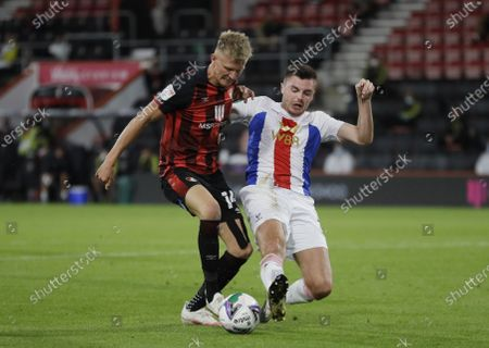 Sam Surridge of Bournemouth (L) in action against James Tomkins of Crystal Palace (R) during the English Carabao Cup second round match between Bournemouth and Crystal Palace in Bournemouth, Britain, 15 September 2020.