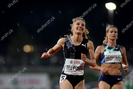 Ajla del Ponte from Switzerland, left, wins the 100m women's race next to Dafne Schippers from the Netherlands, right, during the athletics meeting Gala dei Castelli in Bellinzona, Switzerland, on Tuesday, September 15.