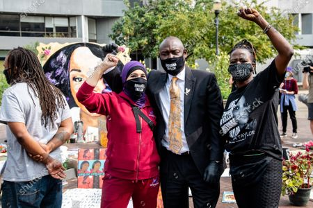 """Stock Photo of Linda Sarsour, from left, of Until Freedom and Attorney Ben Crump are seen in 'Injustice Square"""" outside of City Hall following the civil hearing for Breonna Taylor's family on September 15, 2020 in Louisville, KY. The city has agreed to pay 12 Million to Breonna Taylor's family in a wrongful death lawsuit. This is the largest wrongful death settlement for an African American woman."""