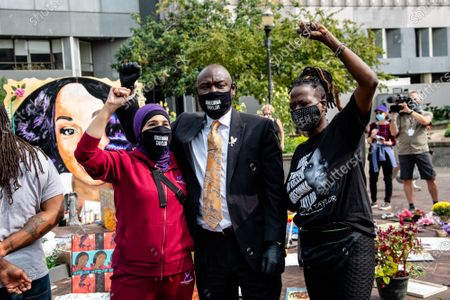 """Stock Image of Linda Sarsour, from left, of Until Freedom and Attorney Ben Crump are seen in 'Injustice Square"""" outside of City Hall following the civil hearing for Breonna Taylor's family on September 15, 2020 in Louisville, KY. The city has agreed to pay 12 Million to Breonna Taylor's family in a wrongful death lawsuit. This is the largest wrongful death settlement for an African American woman."""