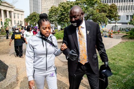 """Tamika Mallory and Attorney Ben Crump are seen in 'Injustice Square"""" outside of City Hall following the civil hearing for Breonna Taylor's family on September 15, 2020 in Louisville, KY. The city has agreed to pay 12 Million to Breonna Taylor's family in a wrongful death lawsuit. This is the largest wrongful death settlement for an African American woman."""