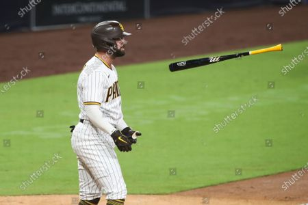 Stock Photo of San Diego Padres' Greg Garcia flips his bat after hitting a foul ball against the Los Angeles Dodgers during a baseball game, in San Diego