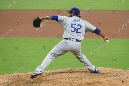 Los Angeles Dodgers relief pitcher Pedro Baez delivers a pitch against the San Diego Padres in a baseball game, in San Diego