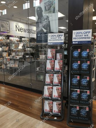 A copy of the book by Bob Woodward, 'Rage' can be seen available, displayed on a sales rack, outside a bookstore in Gurnee, Illinois, USA, 15 September 2020. The book is released after recordings during interviews with US President Donald J. Trump became public, in which he recognized that he underestimated intentionally the gravity of the coronavirus pandemic.