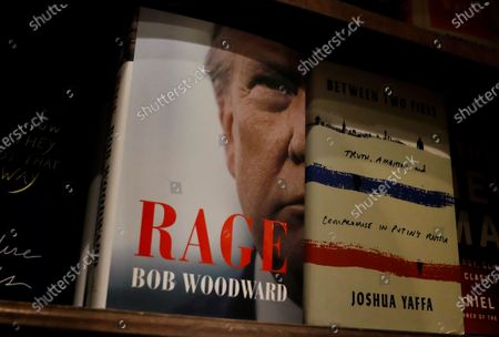 The new book by Bob Woodward 'Rage', seen on a shelf at Shakespeare & Co., in New York, New York, USA, 15 September 2020. The book is released after recordings during interviews with US President Donald J. Trump became public, in which he recognized that he underestimated intentionally the gravity of the coronavirus pandemic.